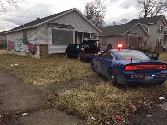 A suspect evading a Michigan State Police trooper crashed into an abandoned Highland Park house Monday.