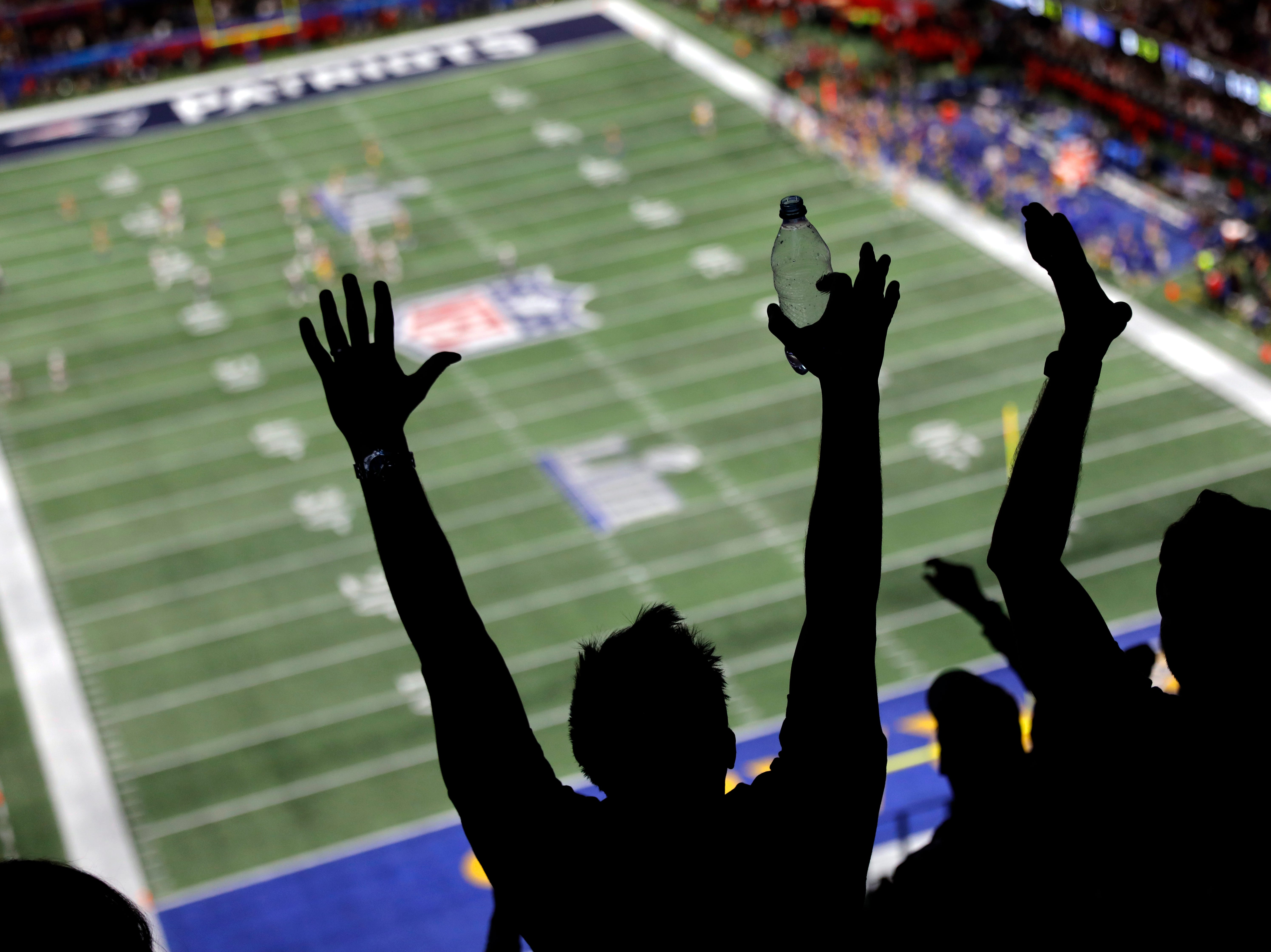 Los Angeles Rams fans celebrate after the New England Patriots fail to convert on a fourth-and-one play in the first half.
