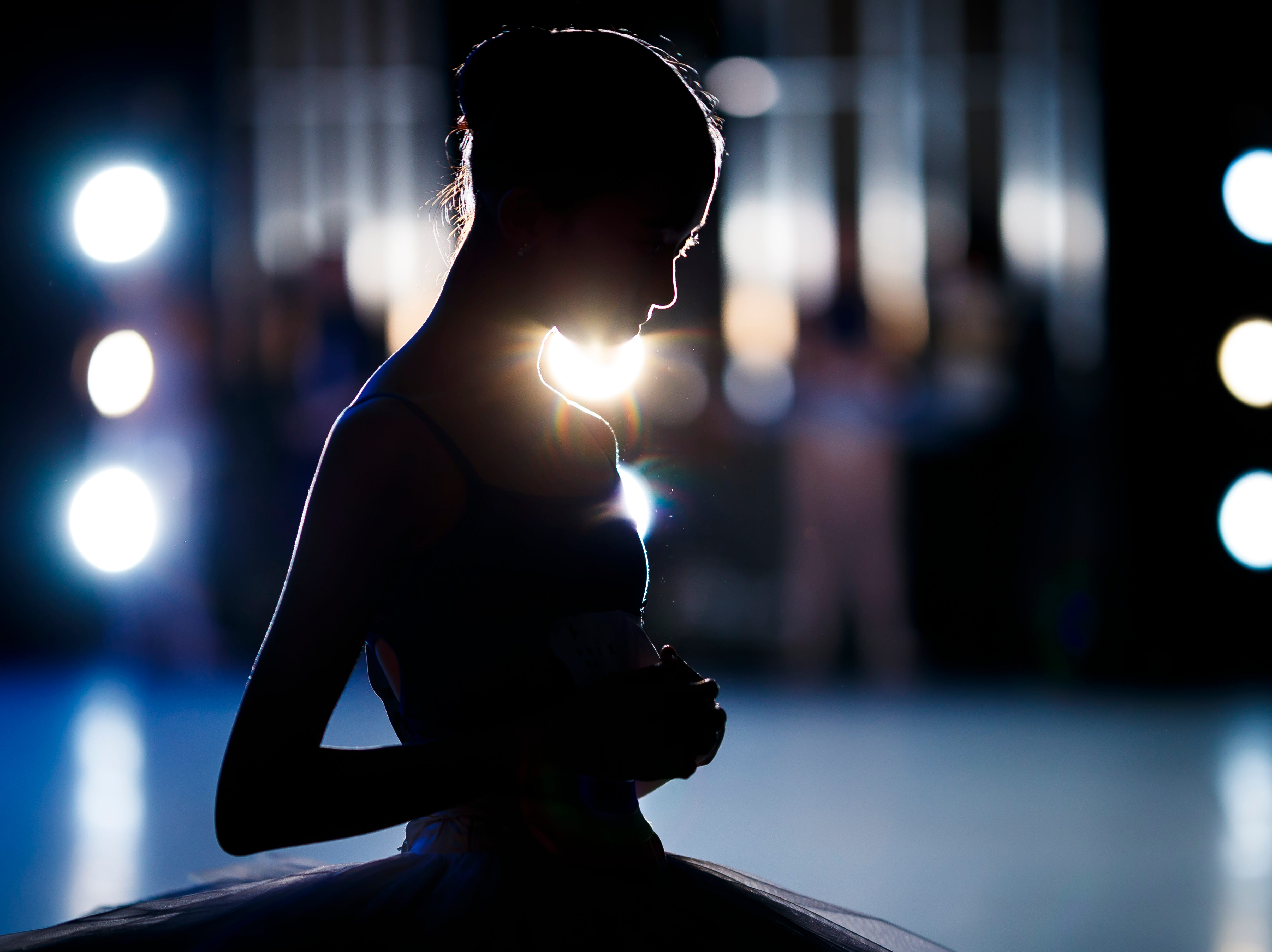 A dancer waits prior to stepping on stage during the first day of the 47th Prix de Lausanne in Lausanne, Switzerland, Monday, Feb. 4, 2019. Launched in 1973, the Prix de Lausanne is an international dance competition for young dancers aged 15 to 18. Closing the six-day event, scholarships granting free tuition in a world-renowned dance school or dance company will be award to the best dancers out of 74 participants this year.