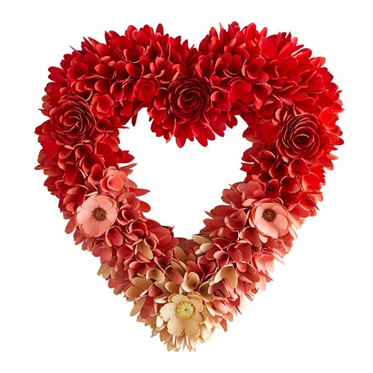 The 20-inch Ombre Wood Curl Heart Wreath sells for $49.99.