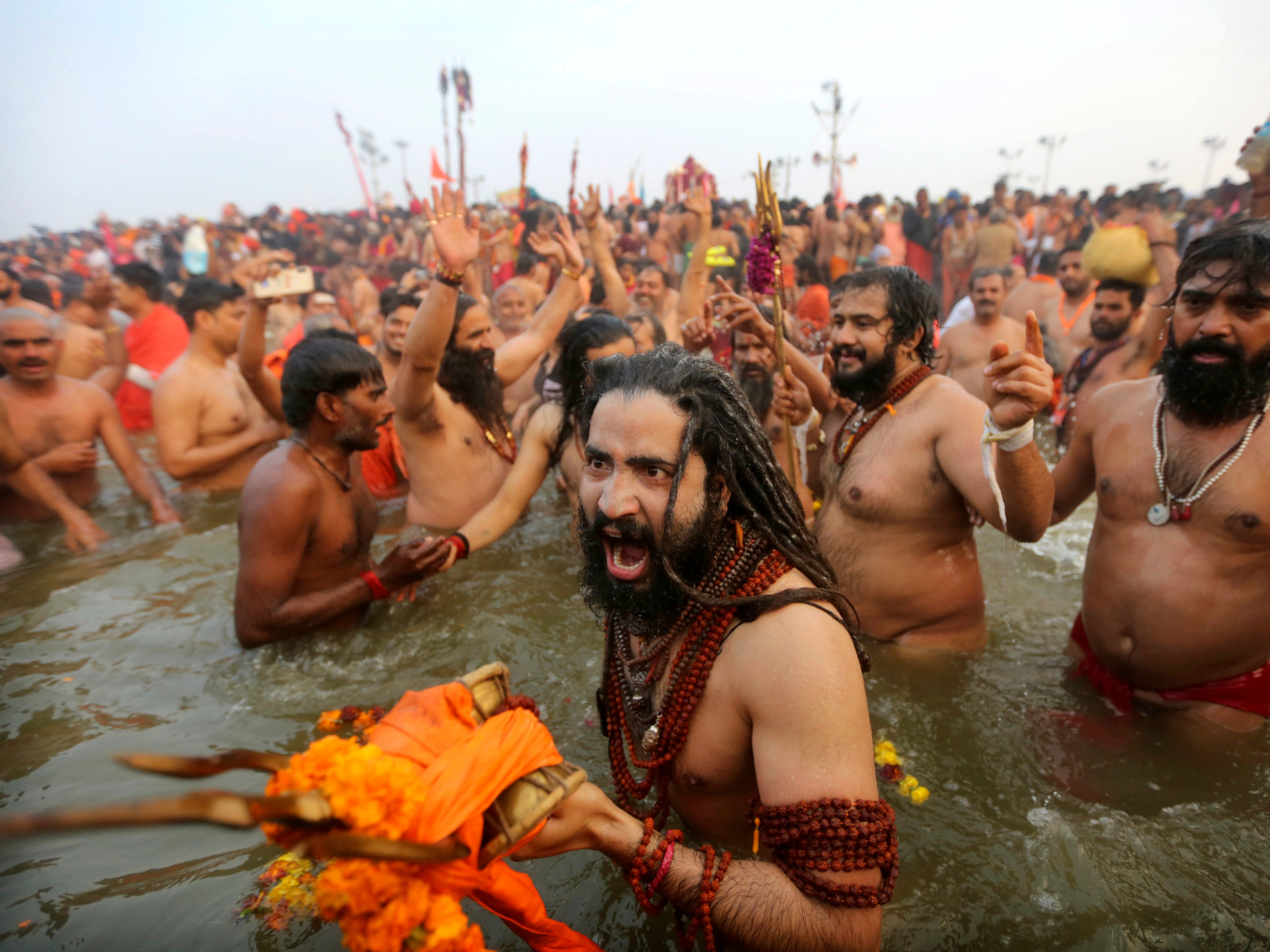 Naga Sadhus or Naked Hindu holy men shout slogans and take dips at Sangam, the confluence of three sacred rivers  the Yamuna, the Ganges and the mythical Saraswati, on Mauni Amavsya or the new moon day, the most auspicious day during the Kumbh Mela or the Pitcher Festival, in Prayagraj, Uttar Pradesh state, India, Monday, Feb. 4, 2019. The Kumbh Mela is a series of ritual baths by Hindu sadhus, or holy men, and other pilgrims at Sangam that dates back to at least medieval times. Pilgrims bathe in the river believing it cleanses them of their sins and ends their process of reincarnation. The event, which UNESCO added to its list of intangible human heritage in 2017, is the largest congregation of pilgrims on earth. Some 150 million people are expected to attend this year's Kumbh, which runs through early March.