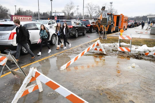 Students file out of Birmingham Seaholm High School at 9:15 a.m. Monday due to a water main break outside the school.