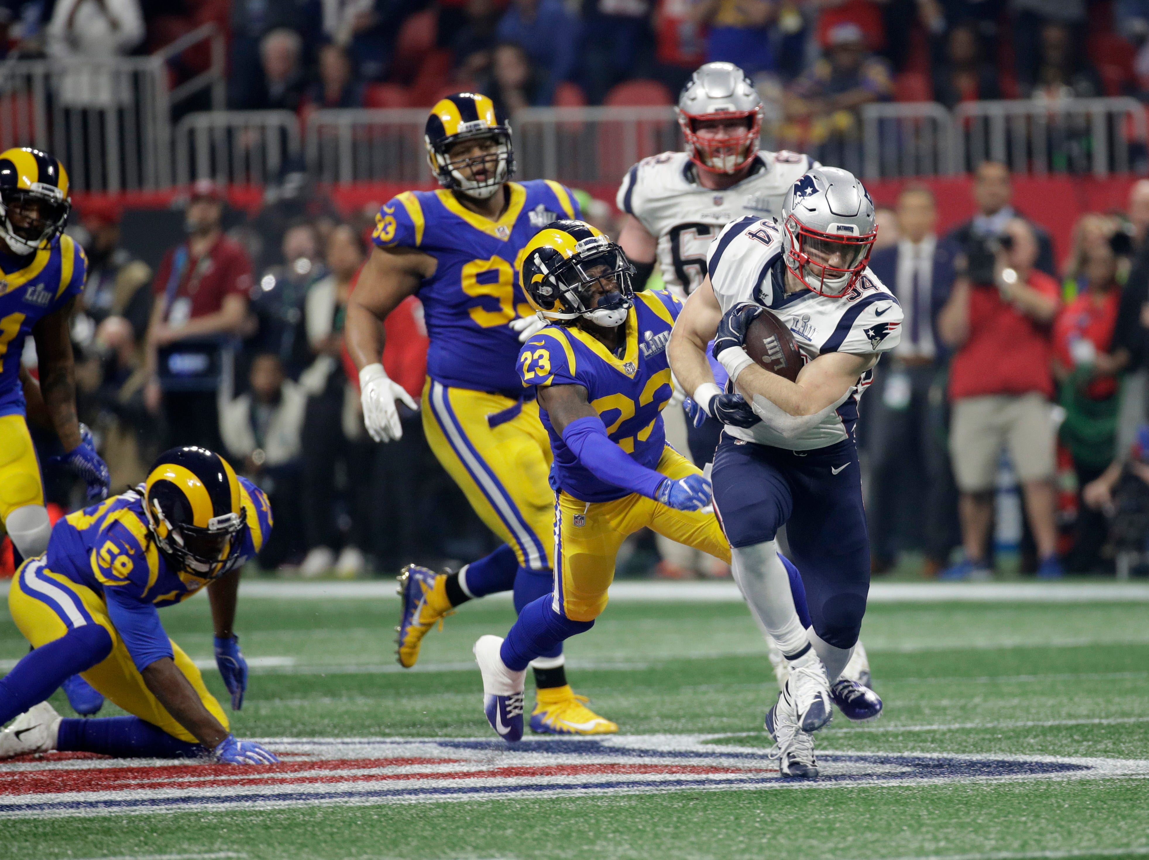 New England Patriots' Rex Burkhead (34) runs past Los Angeles Rams' Nickell Robey-Coleman (23) during the second half.