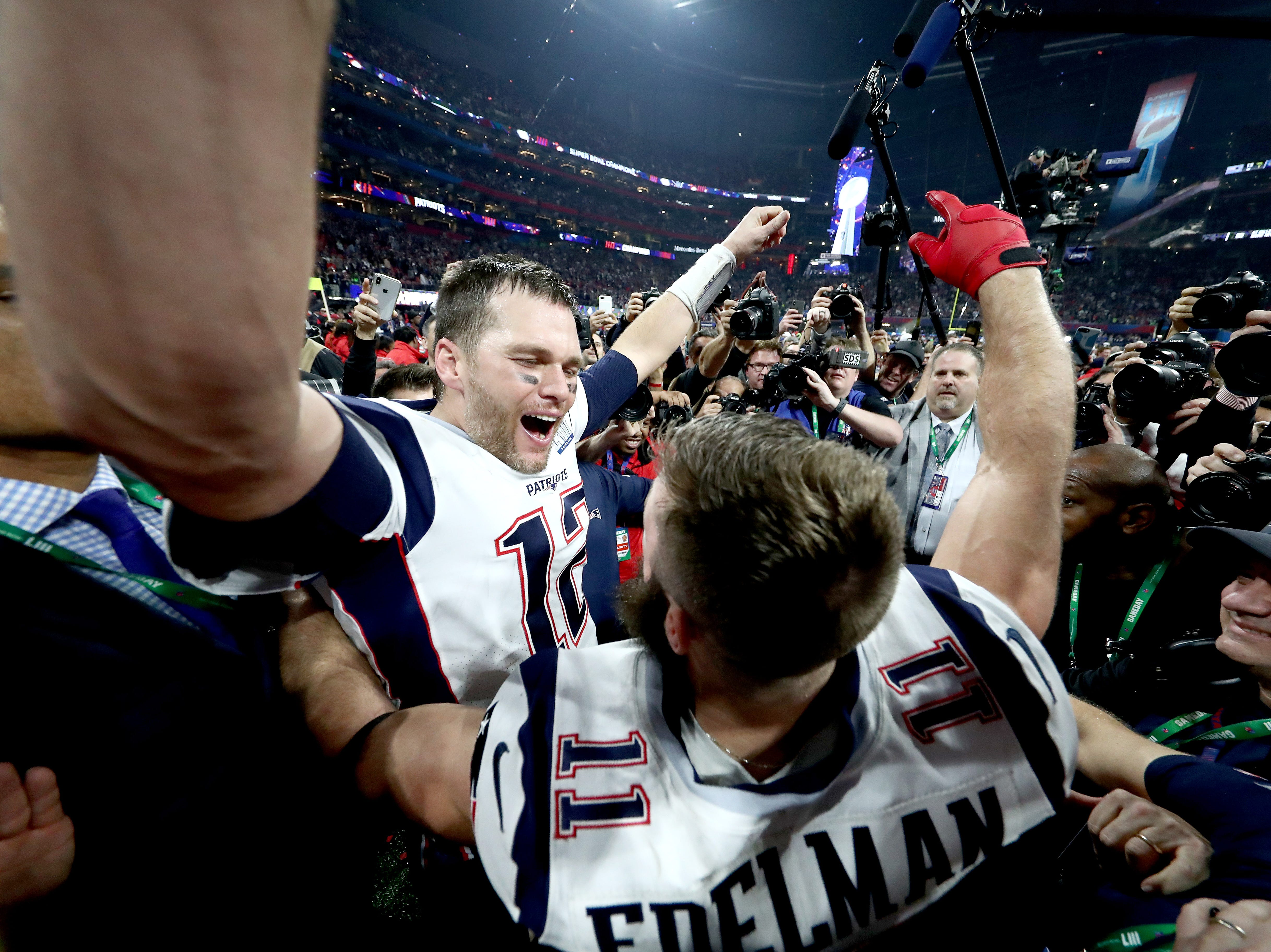 Tom Brady of the New England Patriots and Julian Edelman #11 celebrate their teams 13-3 win over the Los Angeles Rams.