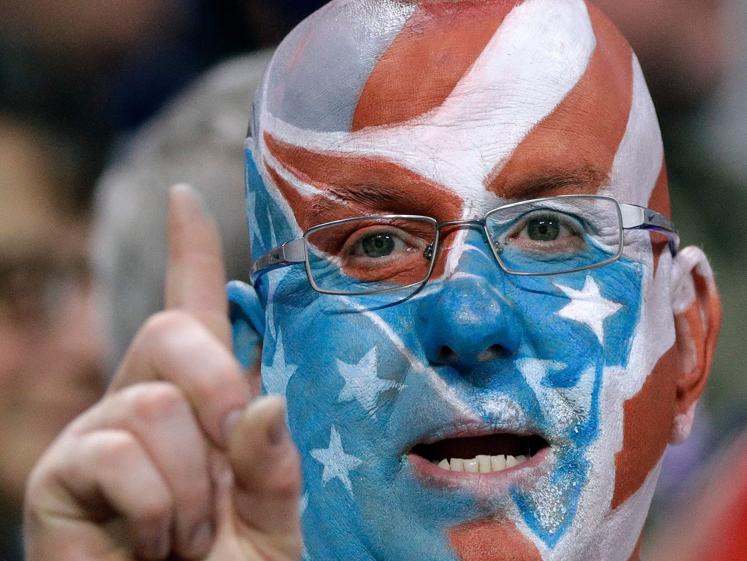 A New England Patriots fan wears team colors during the first half.
