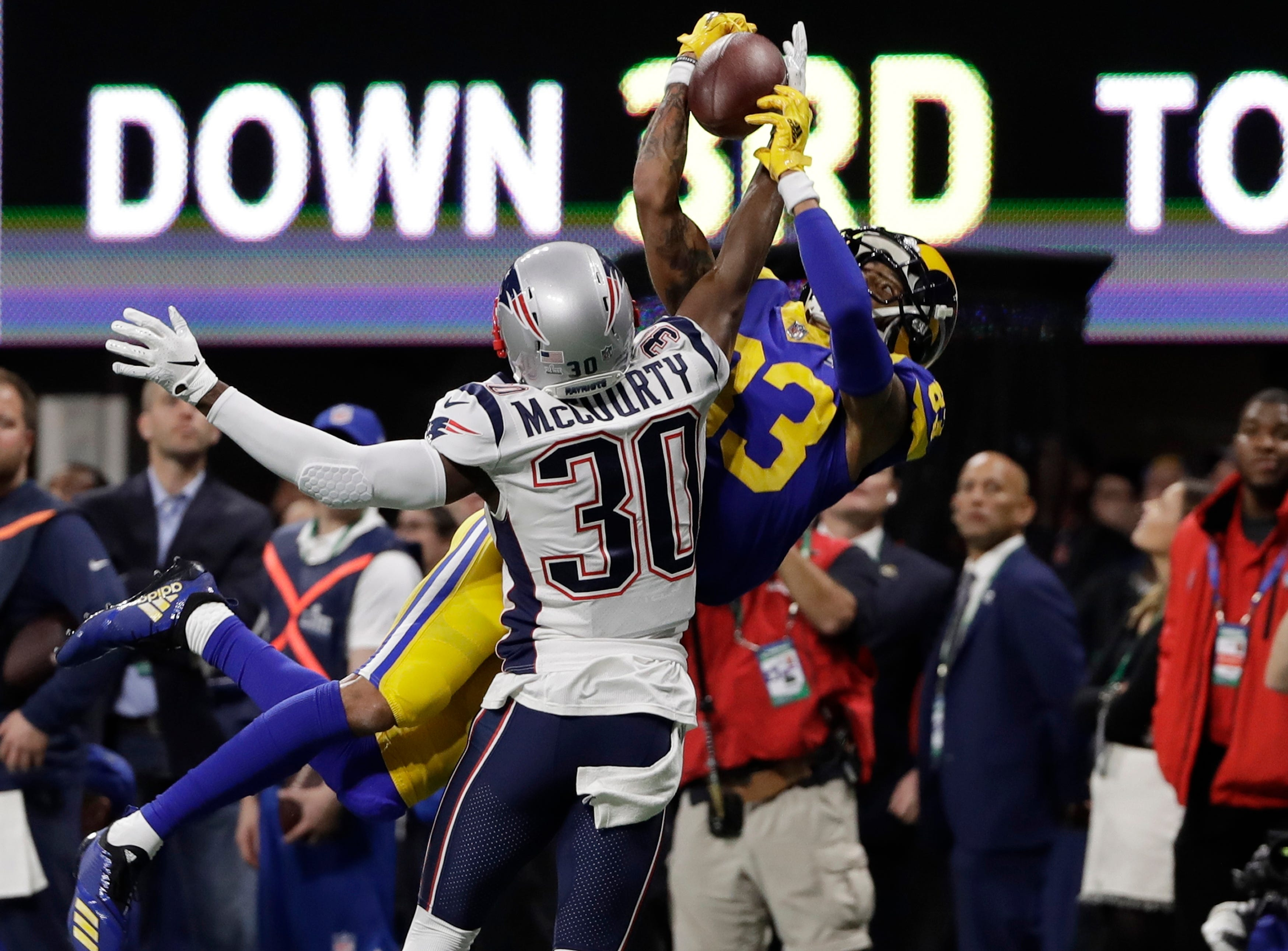 New England Patriots' Jason McCourty (30) breaks up pass intended Los Angeles Rams' Josh Reynolds (83), during the first half.