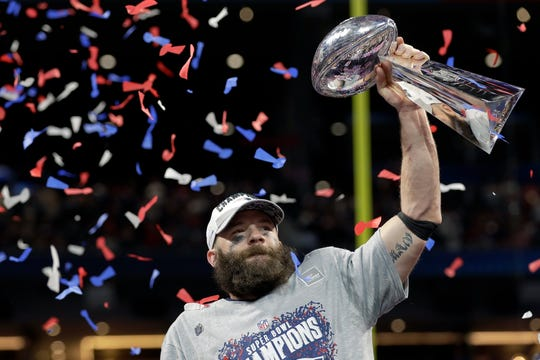 New England's Julian Edelman holds the Lombardi trophy after the game.
