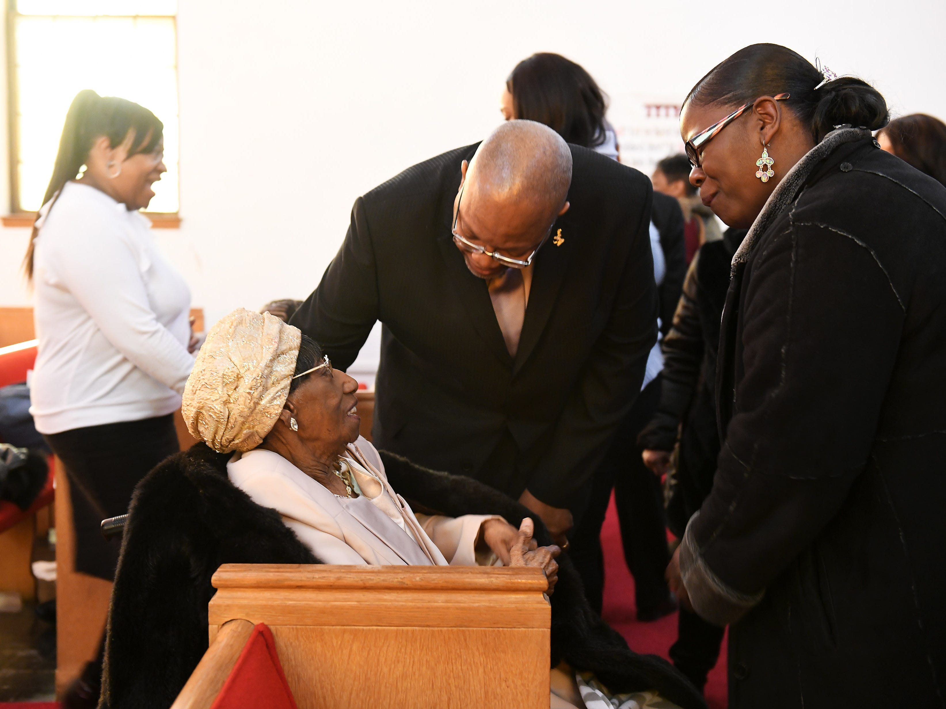 """""""Mother"""" Lois Holden, 109, left, talks with Pastor Eugene Cole and his wife, Georgea Cole of V.O. Greater City Church Detroit after the service at Mount Calvary Baptist Church in Detroit on Feb. 3, 2019. The church congregation, family and friends celebrate the life of Lois Holden, aka """"Mother"""" Lois Holden, who just turned 109 years old."""