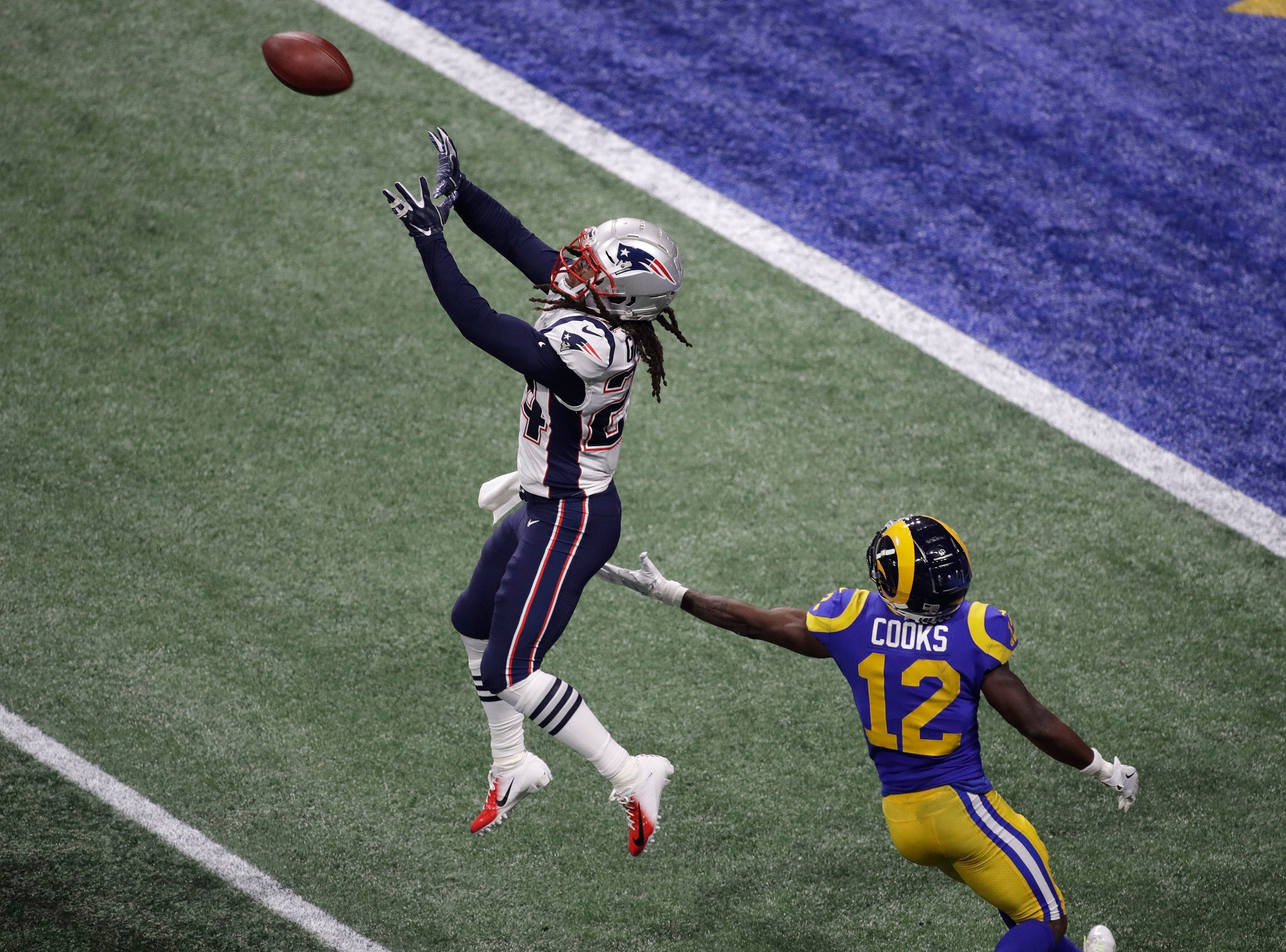 New England Patriots' Stephon Gilmore (24) prepares to intercept the ball against Los Angeles Rams' Brandin Cooks (12) during the second half.