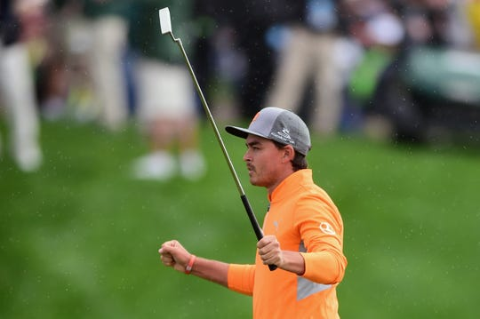 Rickie Fowler celebrates following his winning par putt on the 18th green Sunday.