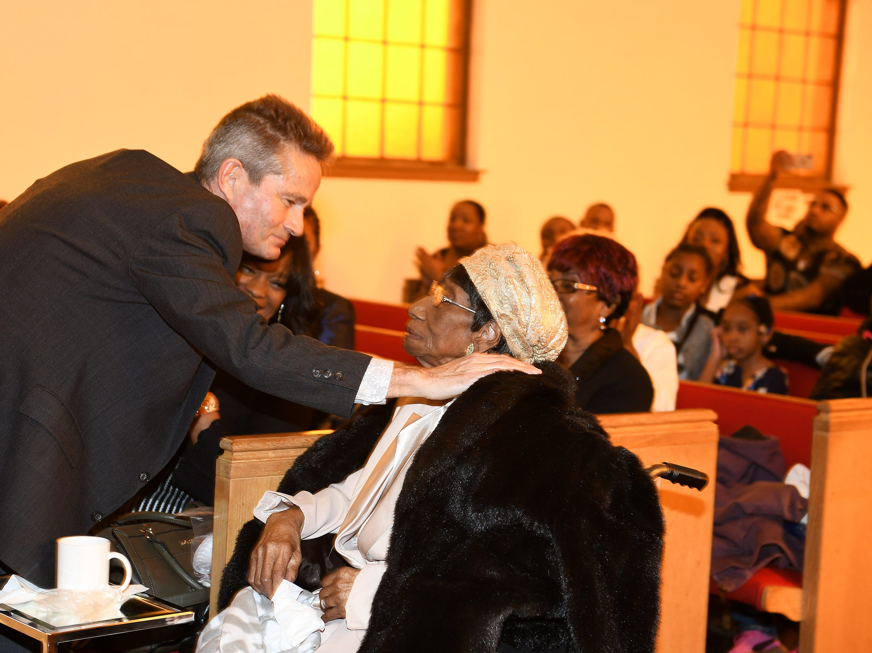"John Awrey of Brighton hugs his ""second mom,"" Lois Holden, 109, right, at Mount Calvary Baptist Church."
