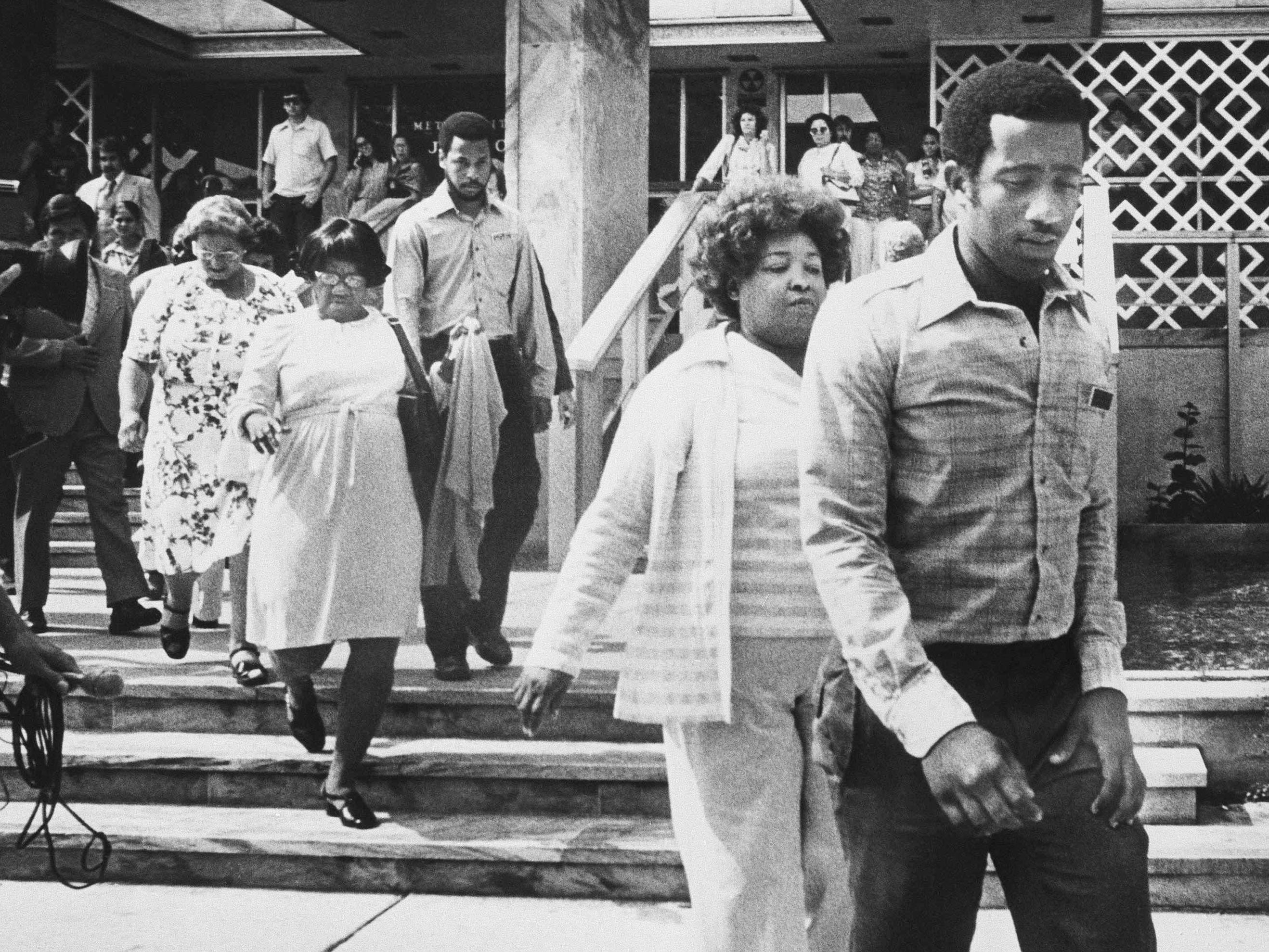 The jury in the Theodore R. Bundy murder trial files out of the Dade County Courthouse after handing down the death sentence, July 31, 1979 in Miami.