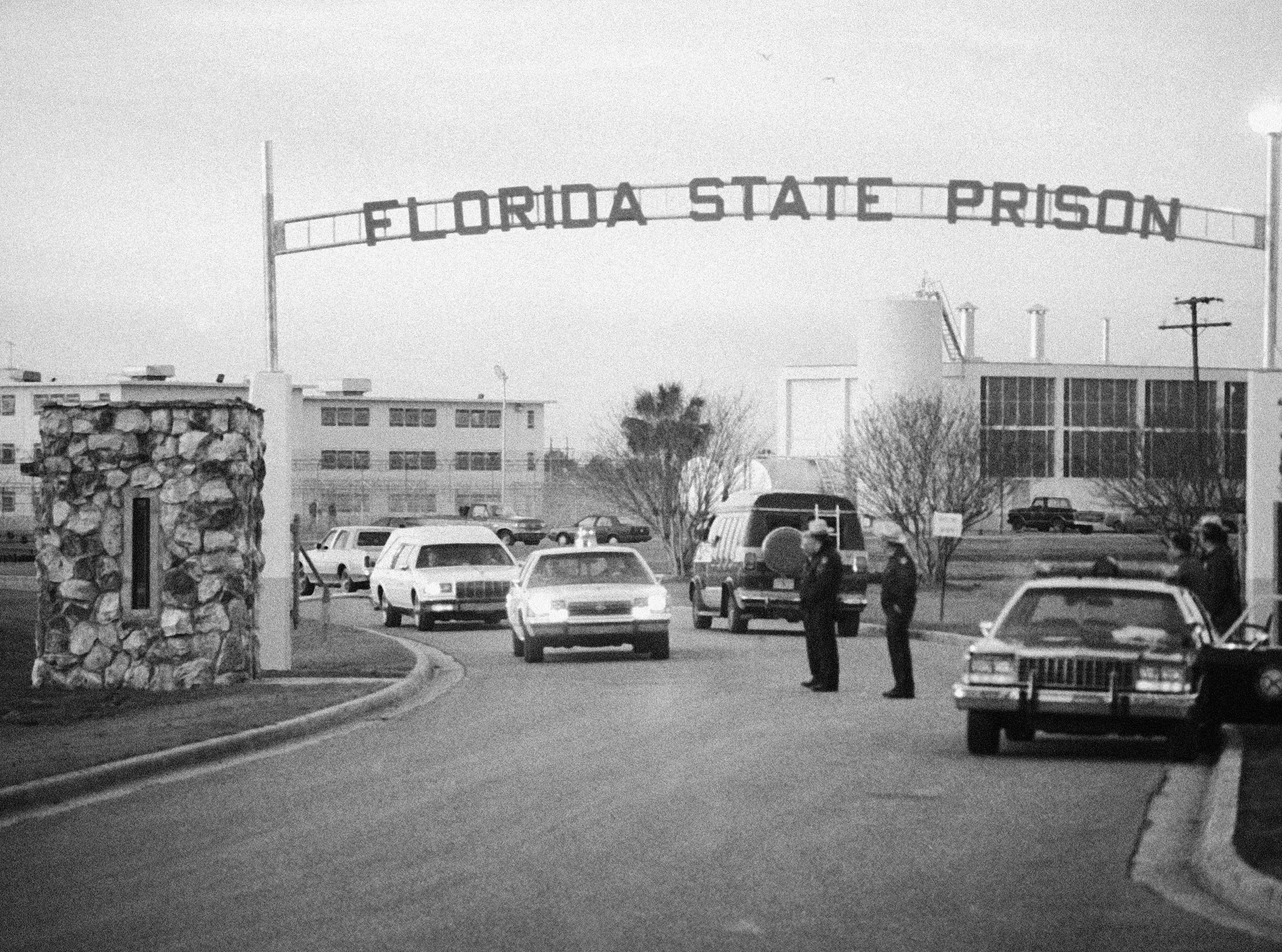 A white hearse leaves Florida State Prison containing the body of Theodore Bundy who was electrocuted in Florida's electric chair, Tuesday, Jan. 24, 1989, Starke, Fla.