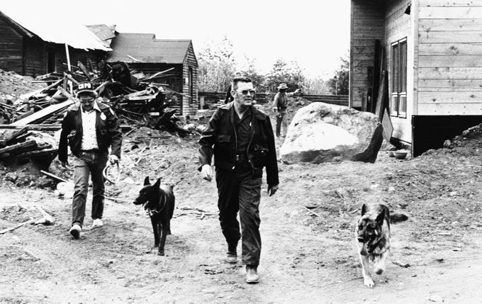 "Police and trained scent dogs search the outlying areas for traces of escaped kidnapper Theodore Bundy, Wednesday, June 9, 1977, Aspen, Colo. Aspen residents leave been described as ""some what miffed"" as the escape and resulting search, and some have described the lax security around the accused murderer as ""patently naive, and bordering on the criminally stupid."""