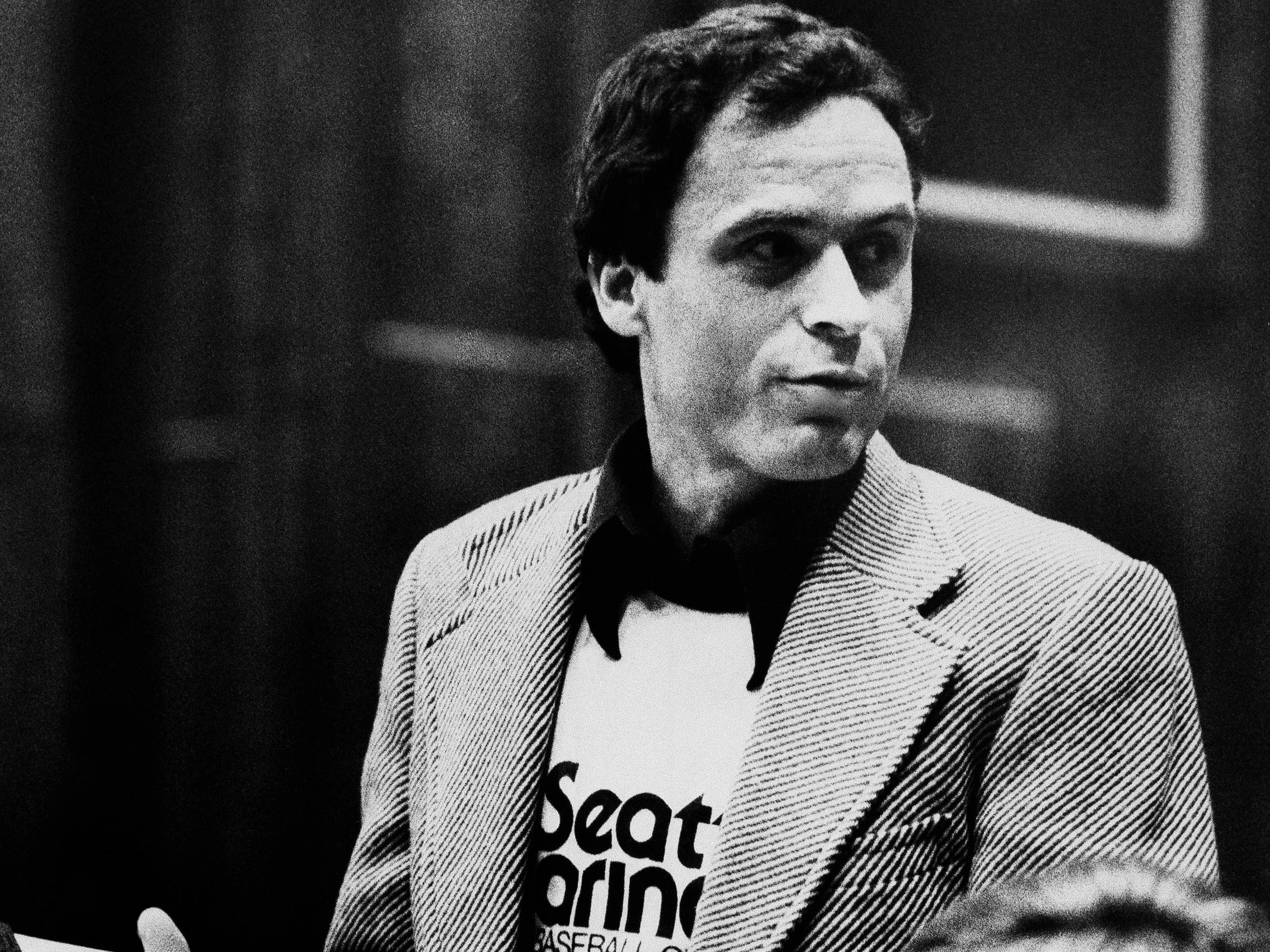 Accused murderer Theodore Bundy, wearing a Seattle Marines T-shirt, presenting his own motions in the Miami courtroom, July 6, 1979, where he is on trial for the murders of two Florida State University coeds in January 1978.