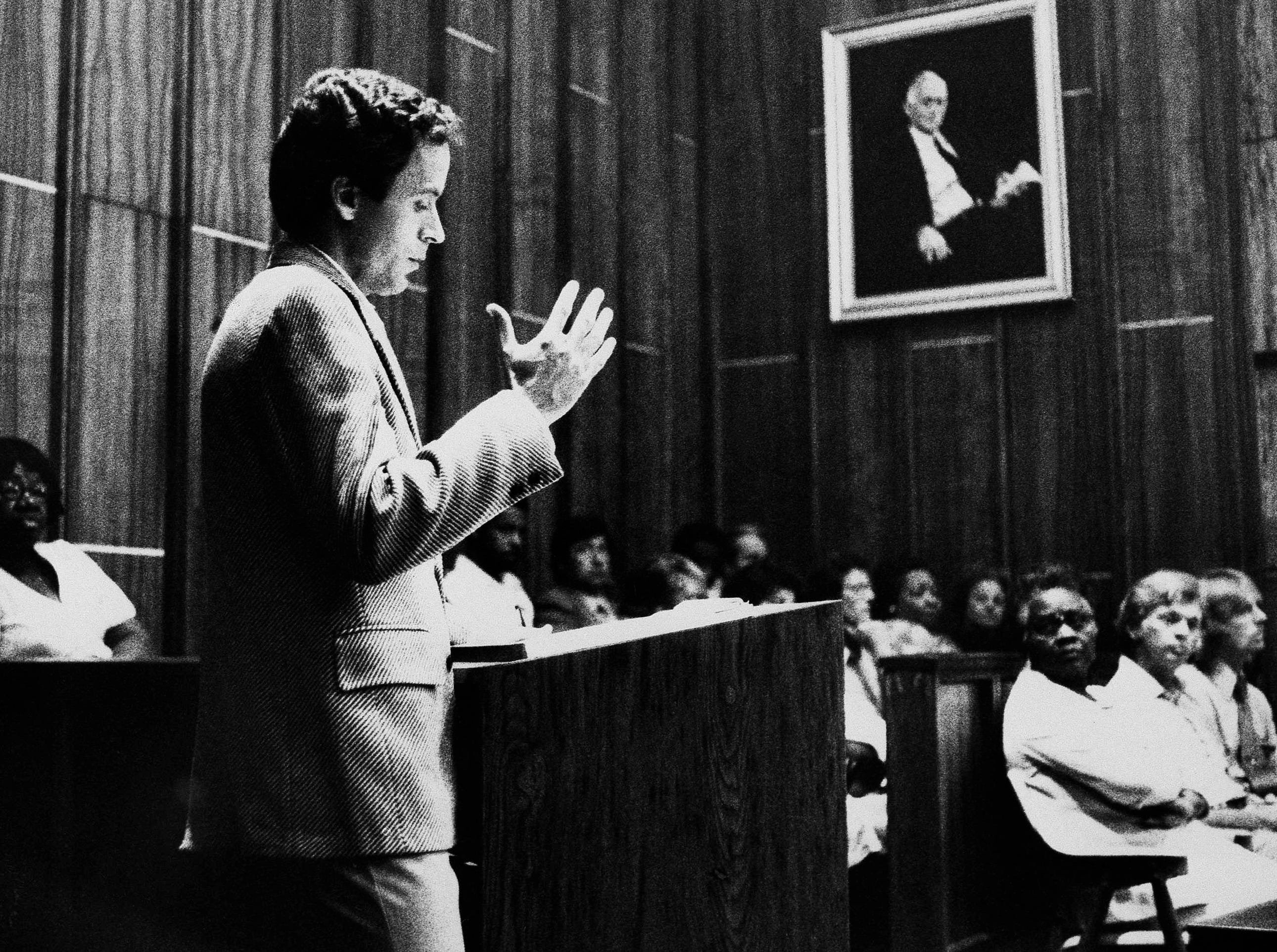 Theodore Bundy gestures as he cross examines witnesses for the prosecution while members of the jury look on in the Miami courtroom, July 9, 1979, where Bundy is on trial for the murders of two Chi Omega sorority sisters.  Bundy is a second year law student is assisting in his own defense.