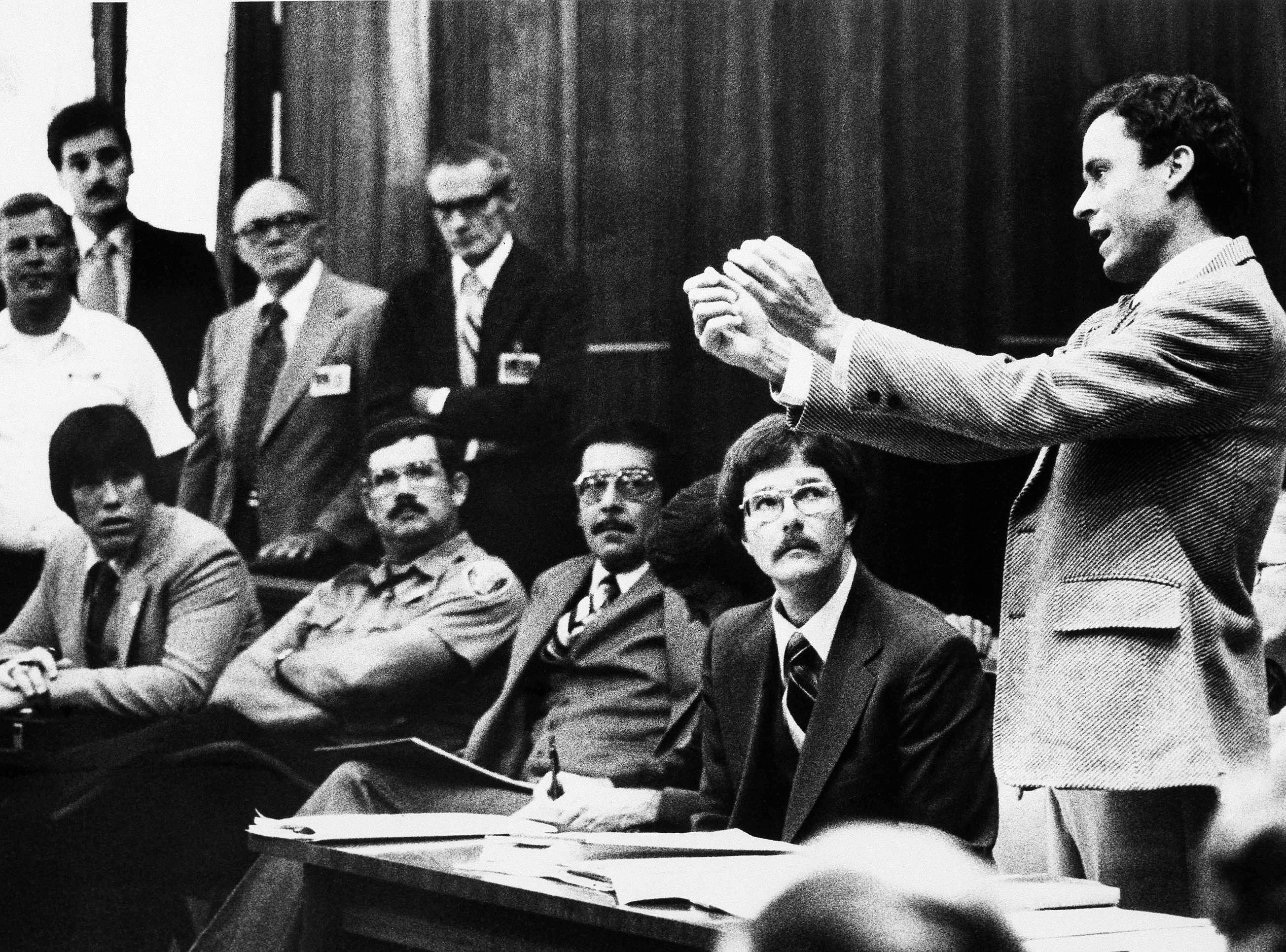 Theodore Bundy gestures as he presents a motion before Circuit Judge Edward Cowart, as Bundy's murder trial got under way in Miami on Monday, June 25, 1979.