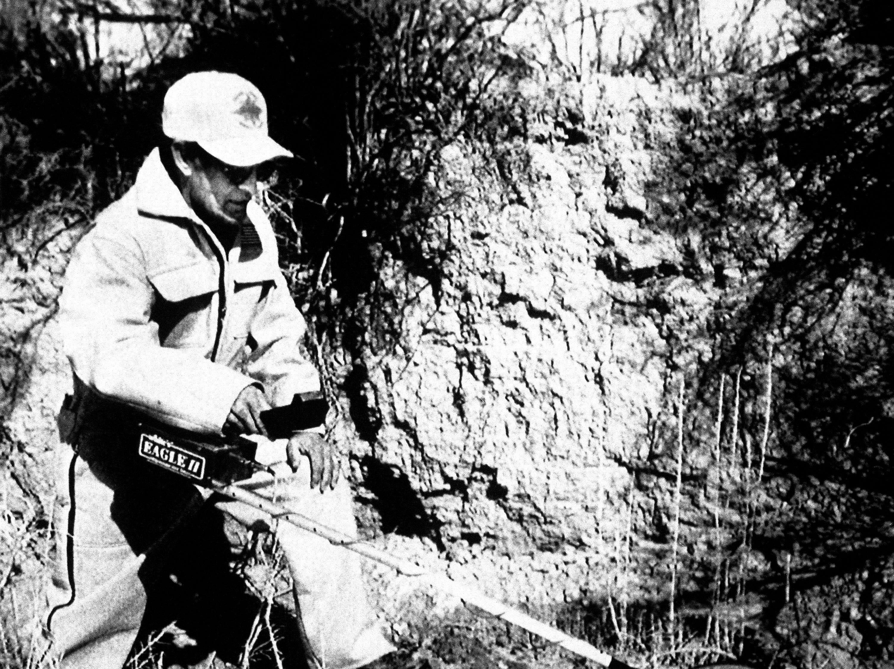 Joe Ruden, from the Carbon County Search and Rescue team uses a metal detector to search for the burial site of Sue Curtis, who disappeared the summer of 1975. Ted Bundy confessed to killing the girl less than an hour before he was executed today in Florida. The searchers were looking in an area that Bundy described, 10 miles south east of Price, Utah.