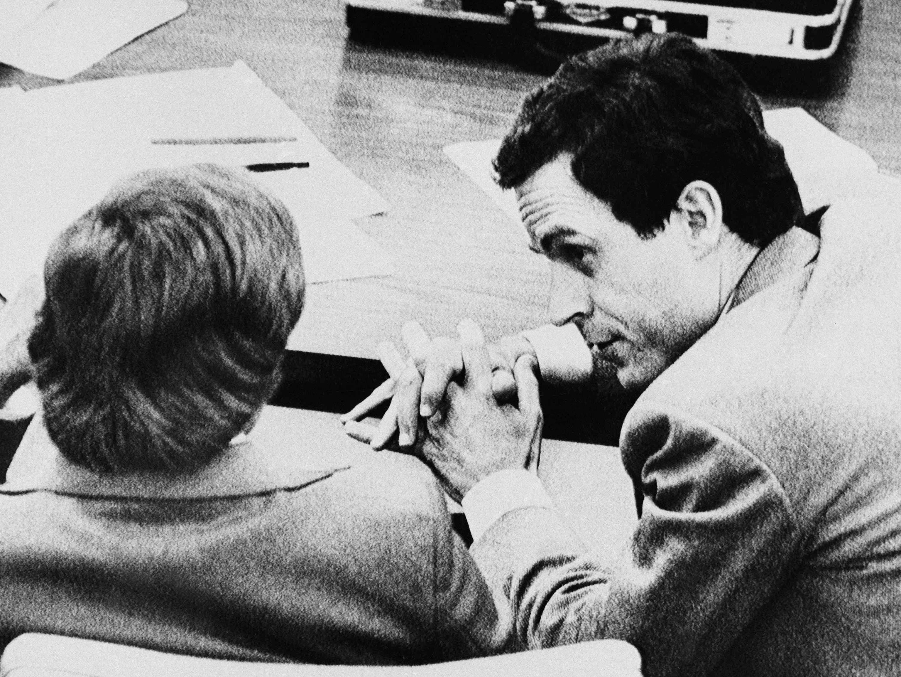 Theodore Bundy confers with his public defender Lynn Thompson, left, during jury selection, Nov. 6, 1979, in Live Oak, Fla.  Bundy is accused in the abduction murder of 12 year-old Kimberly Leach whose body was found near here in Feb. of 1978.