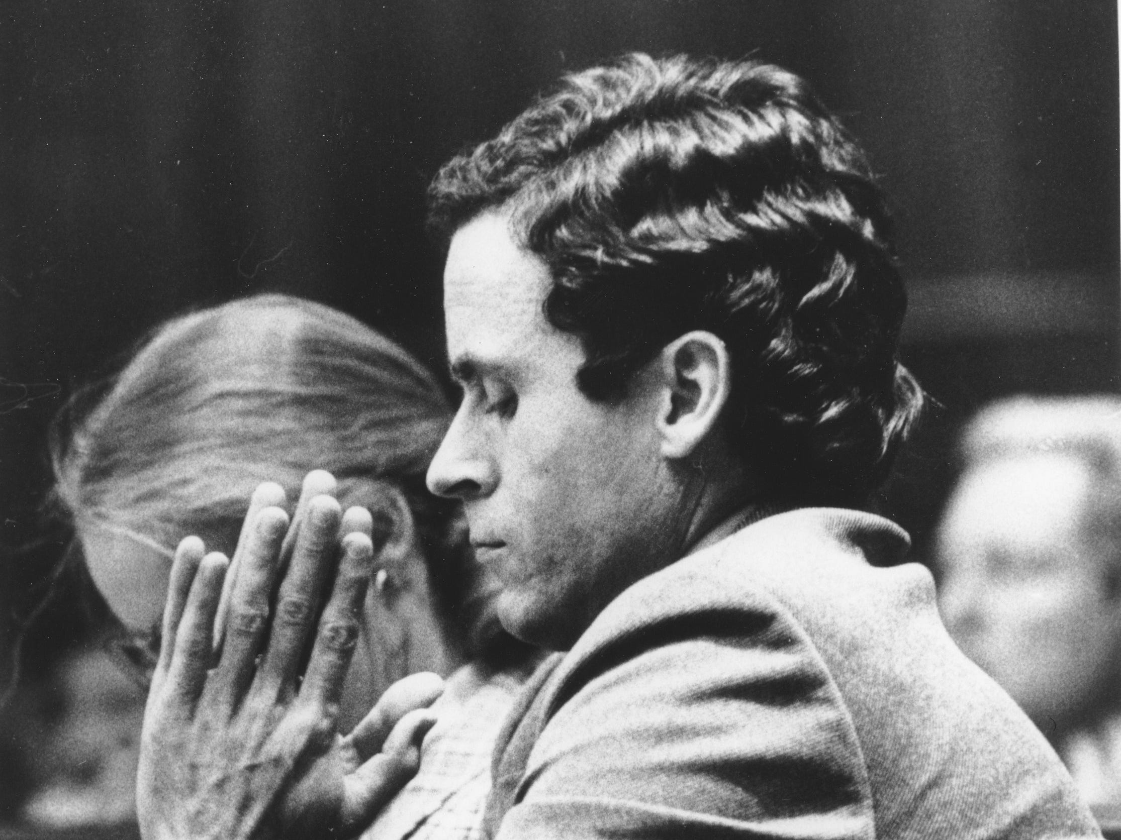 Ted Bundy presses his palms together as judge Edward C. Cowart reads the verdict of the jury of the Theodore Bundy double murder trial in the Dade County courtroom in Miami, Fla., on July 30, 1979.