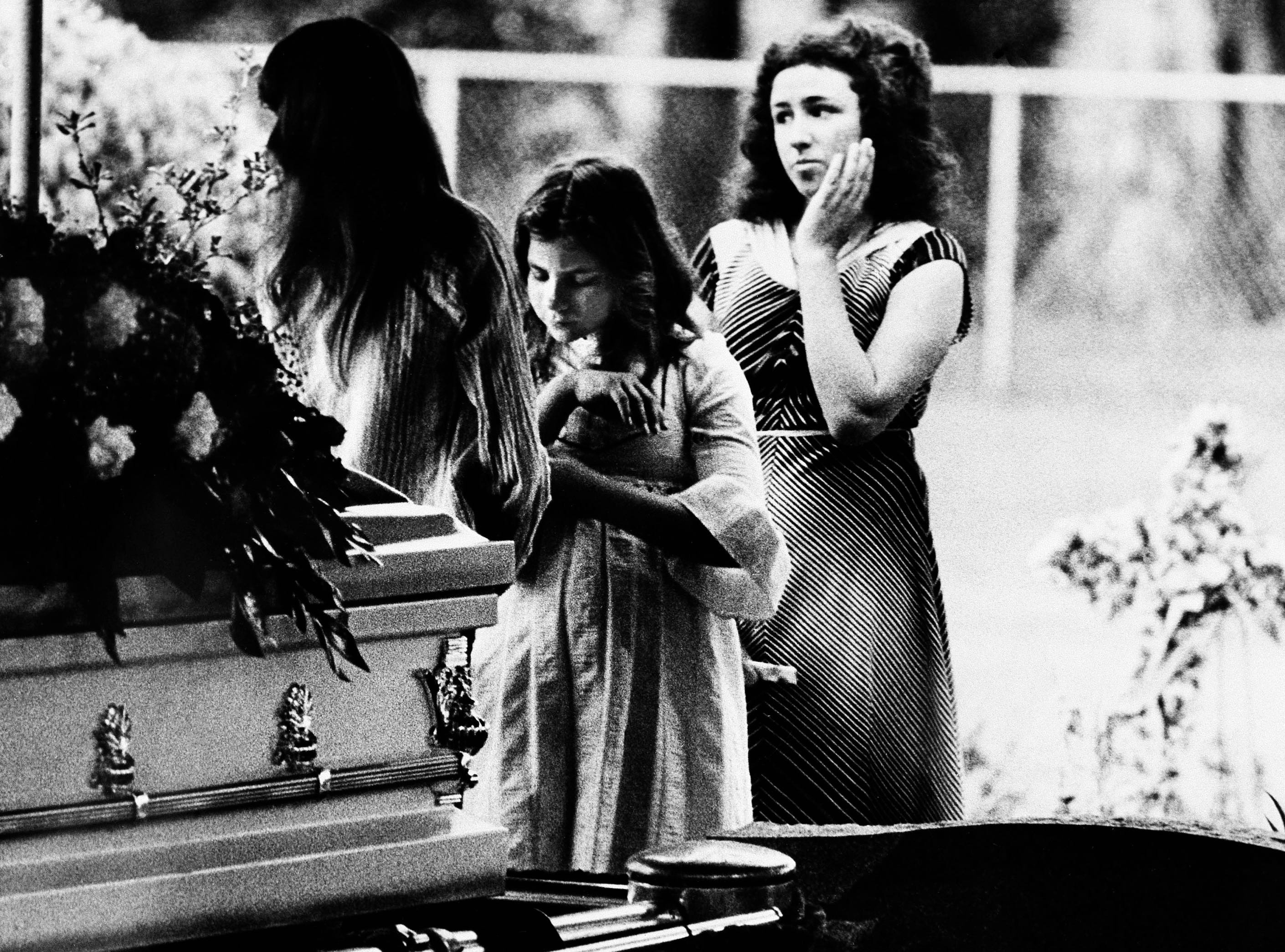 An unidentified classmate says goodbye to Kimberly Leach at the funeral for the 12-year-old Lake City, Fla., girl, April 13, 1978.  She disappeared Feb. 9 and was slain and sexually abused. Her body was found last week.