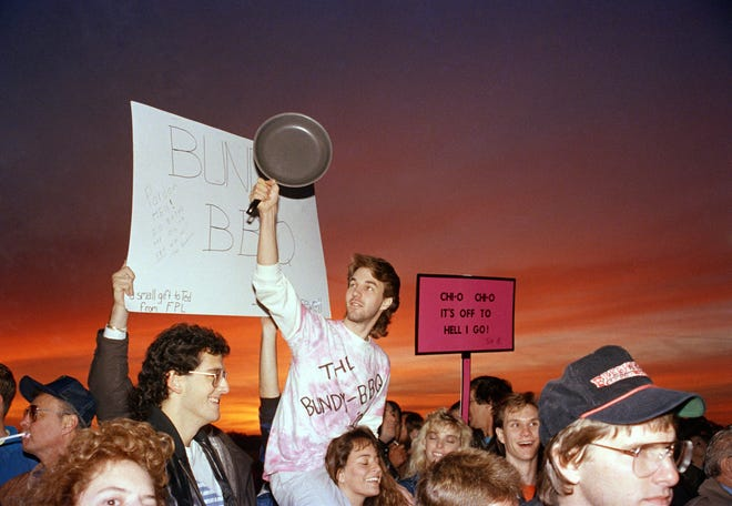 In this file photo, pro-death penalty demonstrators rejoice as the sun rises in the background.