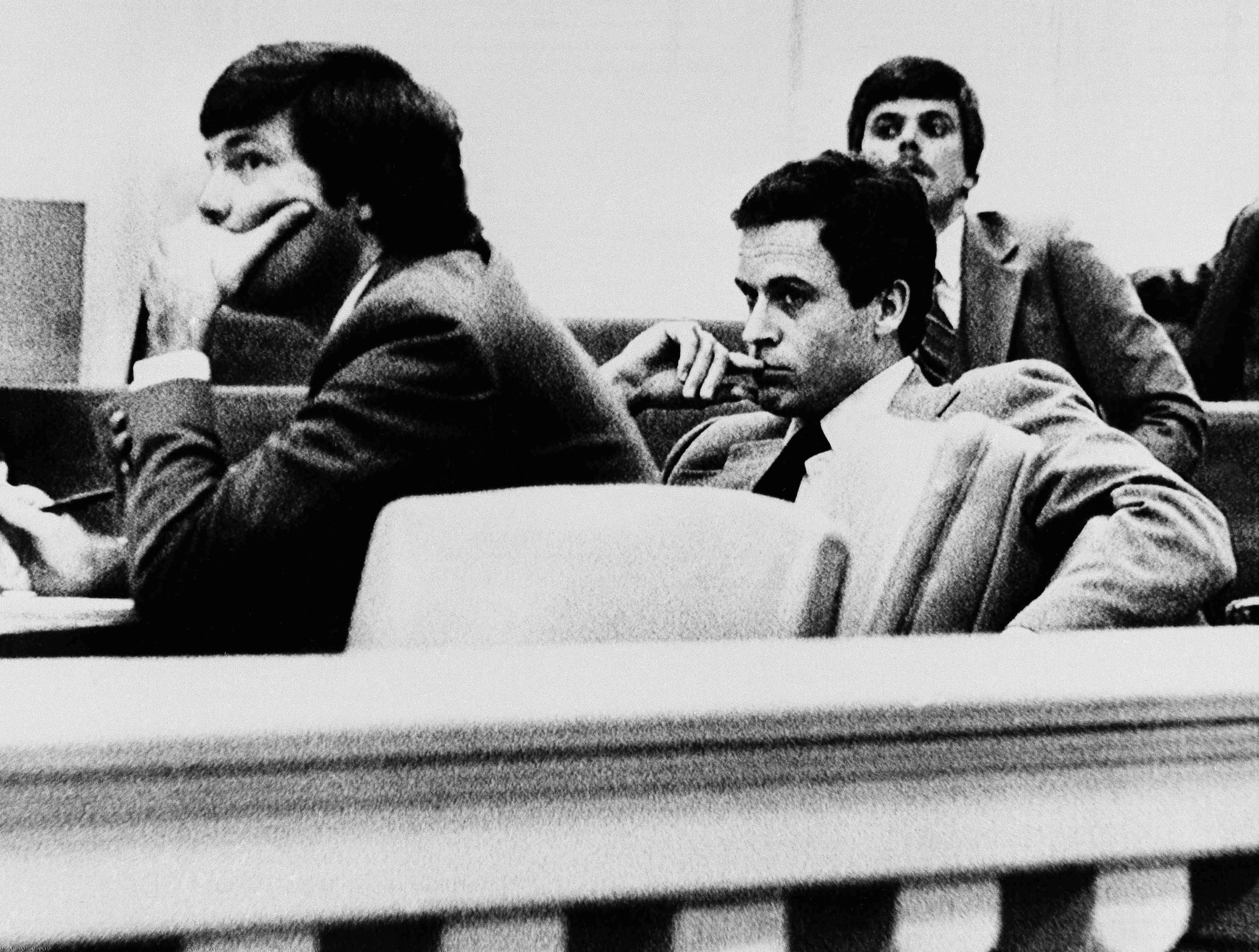 Theodore Bundy, right, listens intently with public defender Lynn Thompson, left, during examination of prospective jurors, Nov. 6, 1979 in Live Oak, Fla.  Bundy is accused of murdering 12-year-old Kimberly Leach who was abducted from her school in Lake City, Fla. in February of 1978.