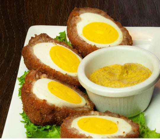 Scotch eggs appear on the new menu at Clancey's in Fort Myers.
