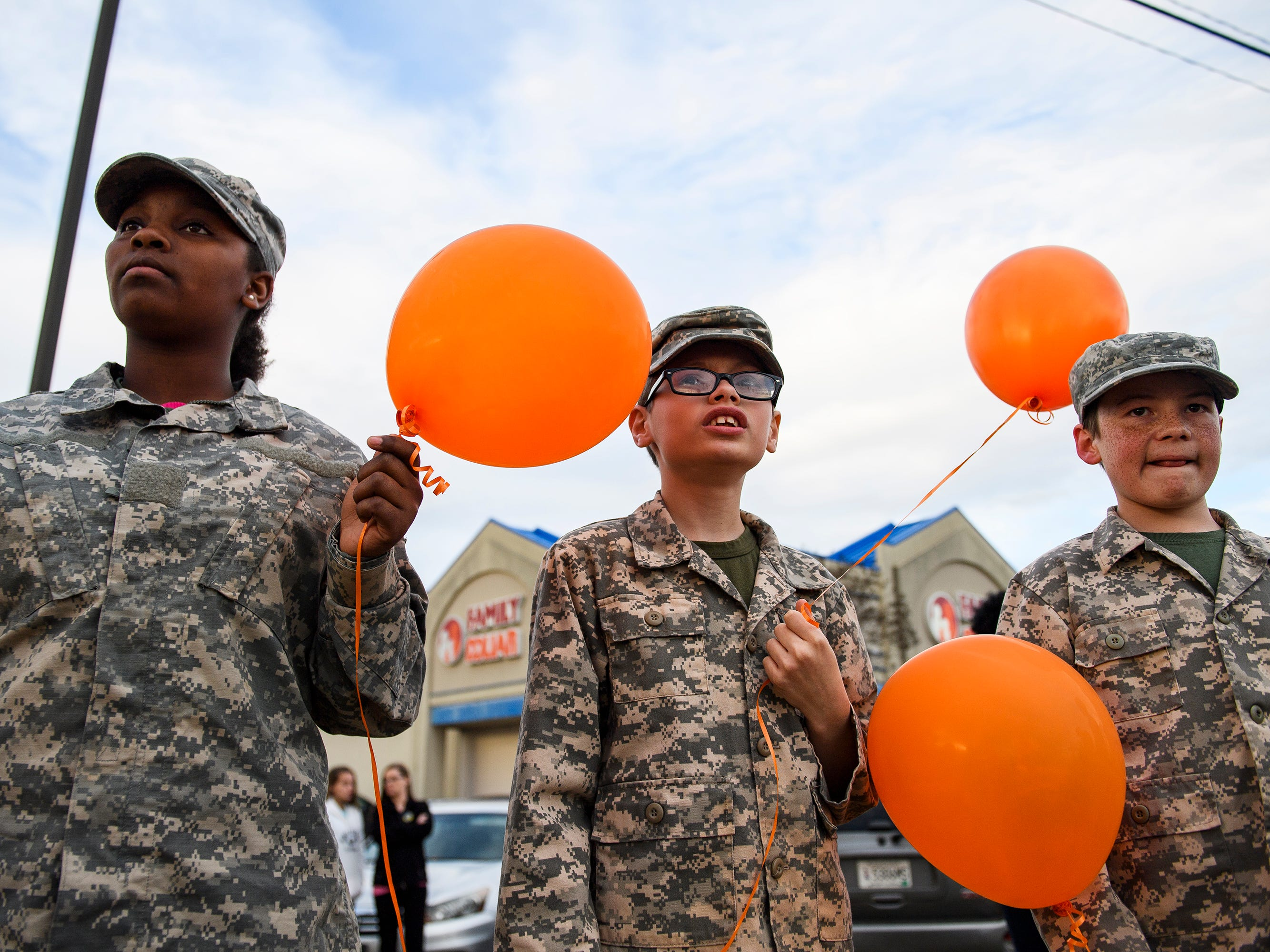 From left, Xenoshha Tate, Donnie Mauldin and Joshua Mauldin hold balloons during a balloon release in honor of Joshua Meeks on East Butler Road in Mauldin on Feb. 4, 2019.