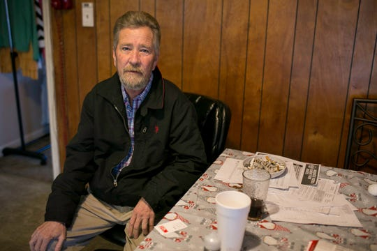 Leslie McCrae Dowless sits in his kitchen in Bladenboro, North Carolina.