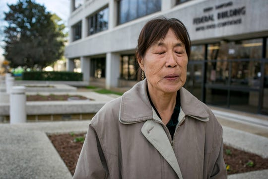 Kyosuk George, 70, of Columbus County, North Carolina, sits outside the United States District Court for the Eastern District of North Carolina in Raleigh after she was sentenced on charges of voting illegally as a noncitizen.
