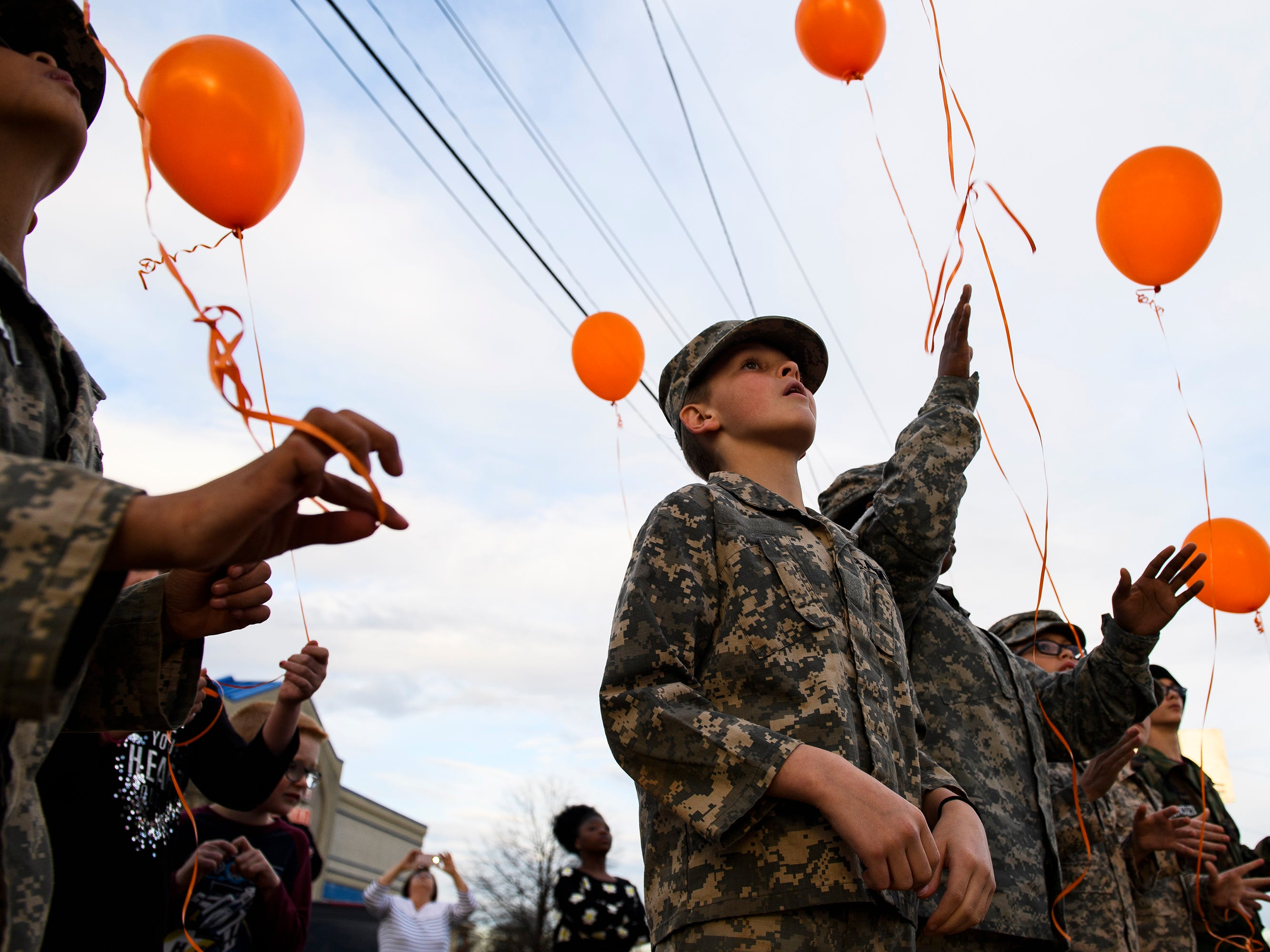 Landon Gore and other children from Strap Em' Up Boot Camp release balloons in the air in honor of Joshua Meeks on East Butler Road in Mauldin on Feb. 4, 2019.