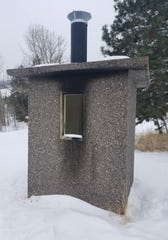 A fire was set to the exterior of the outhouse at Beavertail Pond Fishing Access Site.