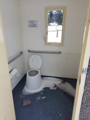 A window was broken out in the outhouse at Beavertail Pond Fishing Access Site.