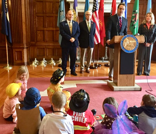 Gov. Steve Bullock talks Monday  about House Bill 225, a school bill, at a news conference.