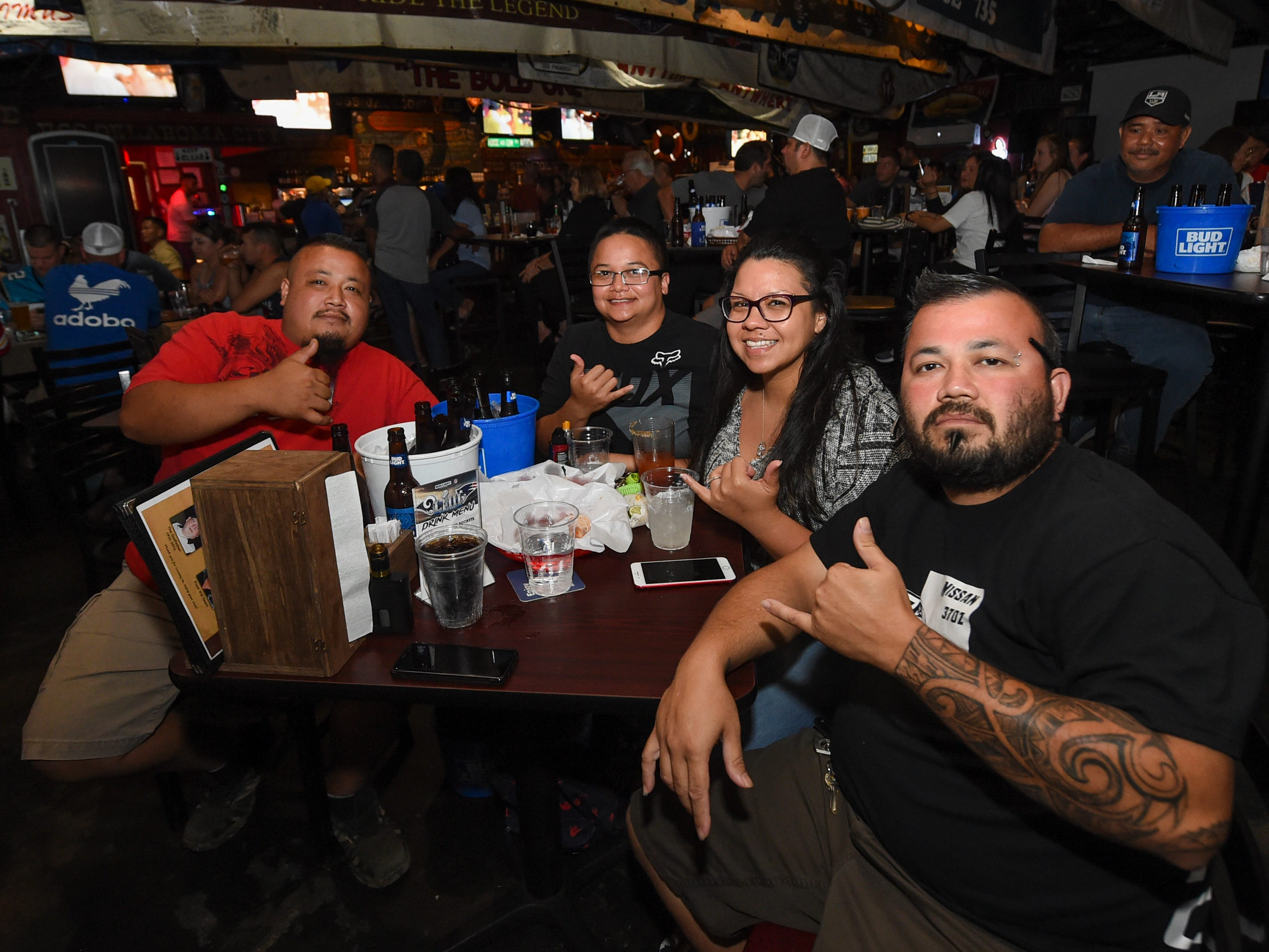 A Superbowl 53 party is held at Horse and Cow Superbowl in Tamuning, Feb. 4, 2019. From left: Ken Aguon, Jasmin Quitugua, Amanda Parker Quitugua, and Frank Aguon.