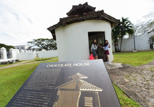 Tourists visit the Chocolate House at the Plaza de España in Hagåtña, Feb. 4, 2019.