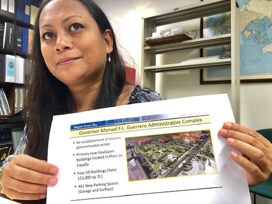 Lasia Casil, acting director of the Hagatna Redevelopment and Restoration Authority, shows on Feb. 4, 2019 an artist rendition of the four priority structures that will be built at Plaza de Espana, including a building for most senators and their staff that are not at the Guam Congress Building and executive agencies, to help cut government of Guam's annual $11.8 million office rentals by some $5.7 million.