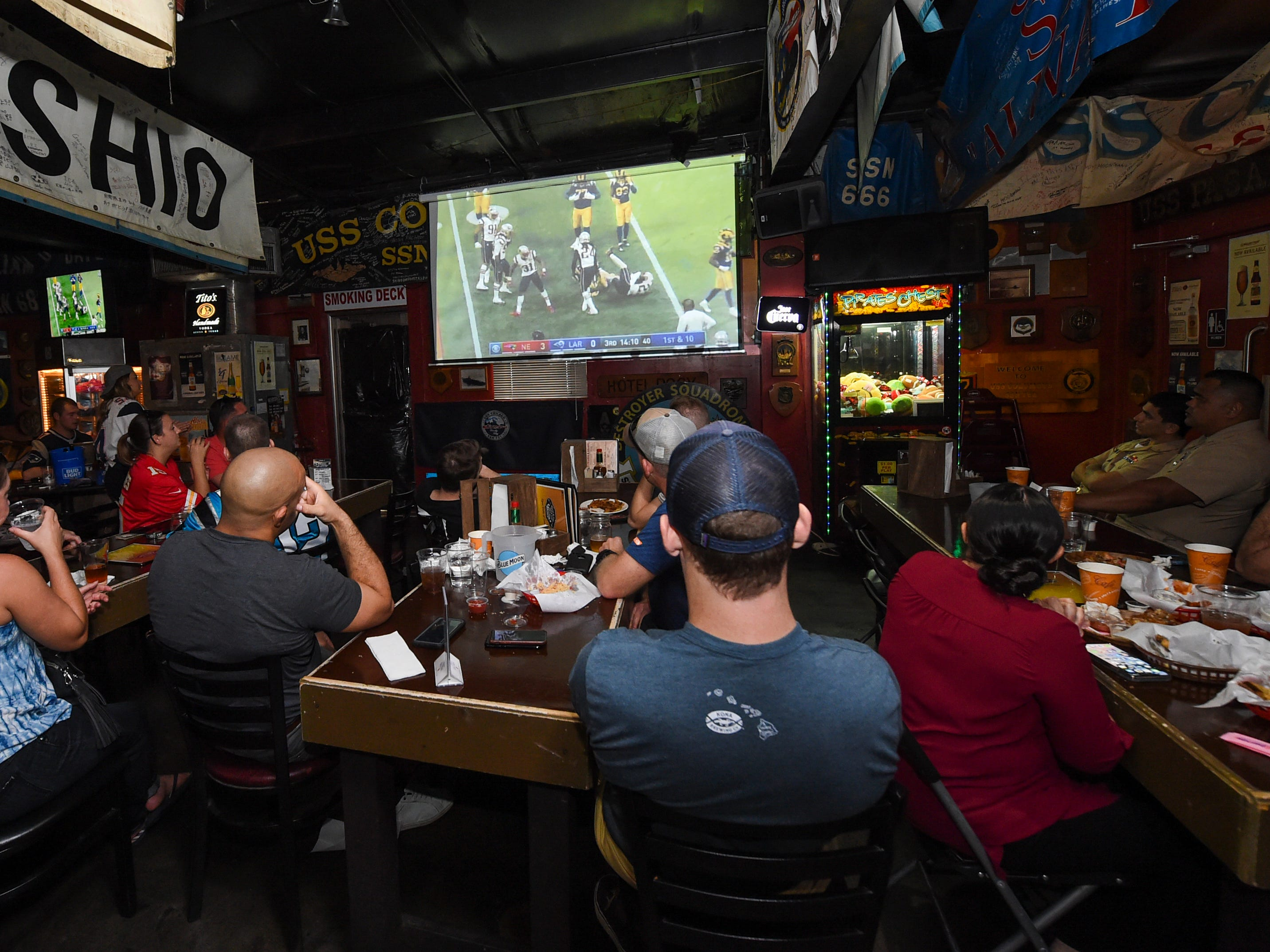 Football fans watch their teams compete during a Horse and Cow Superbowl 53 party in Tamuning, Feb. 4, 2019.