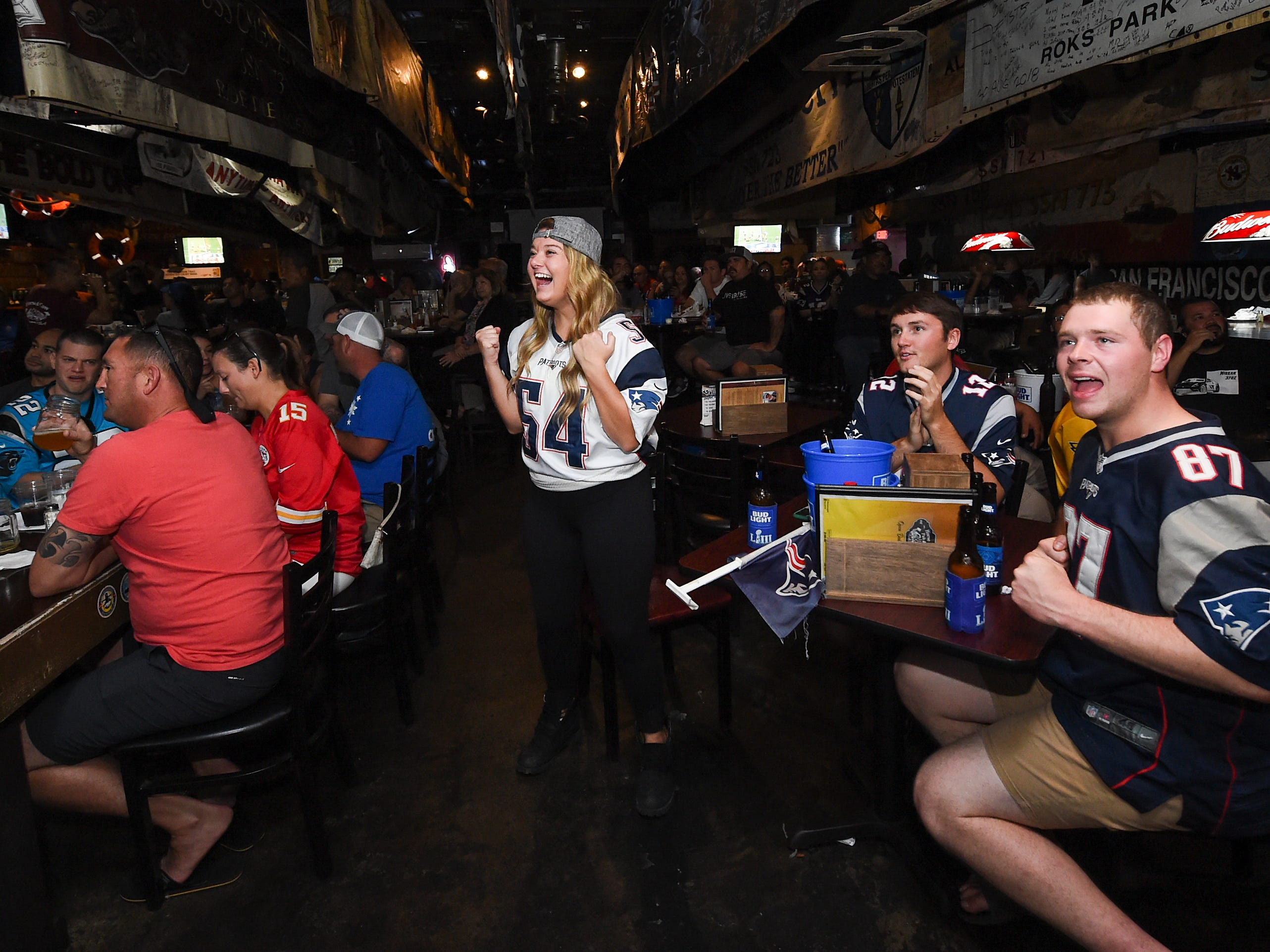 New England Patriots fan Jackie Walsh, standing, celebrates her team's Superbowl 53 run during a Horse and Cow party in Tamuning, Feb. 4, 2019.