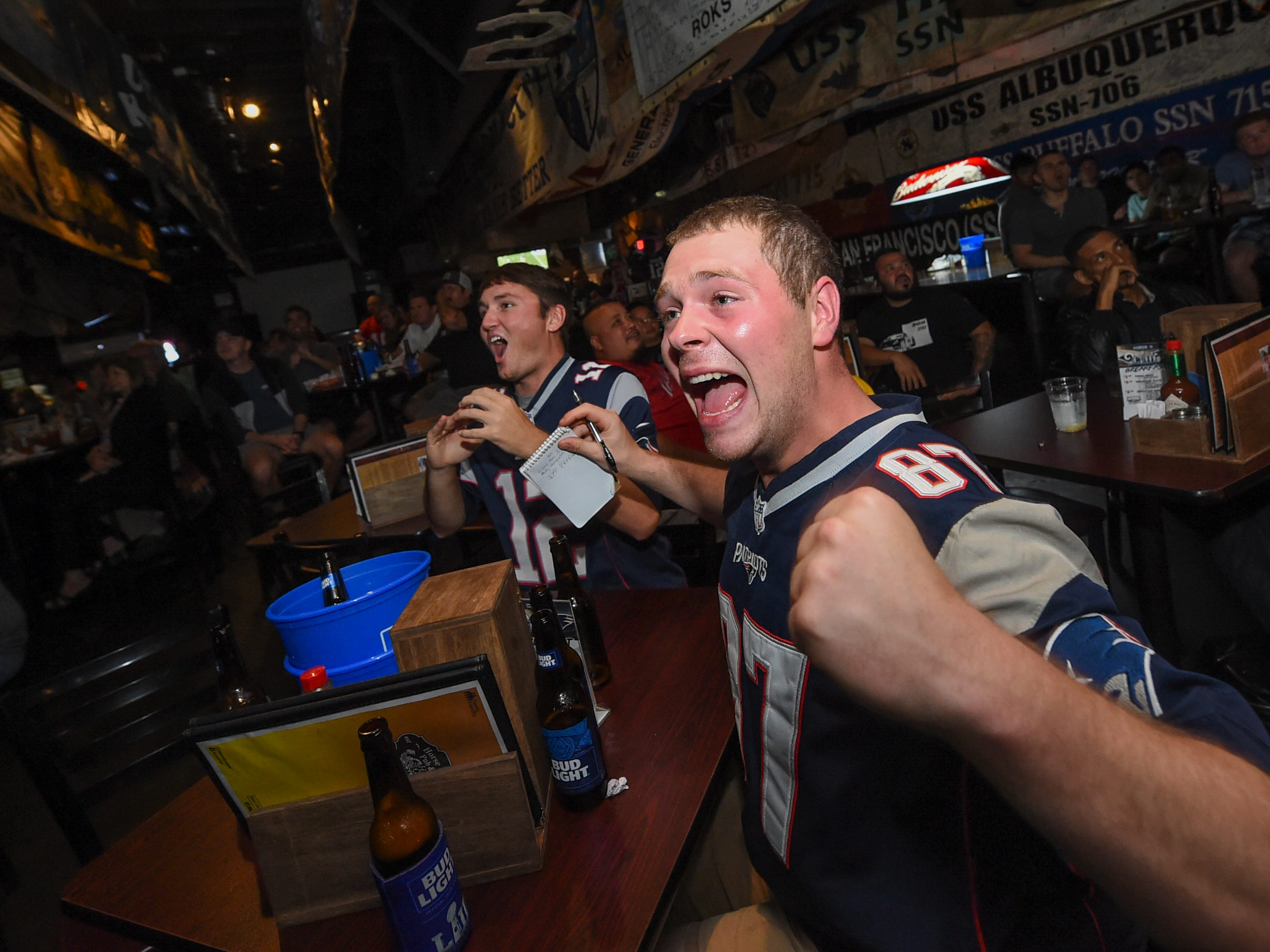 New England Patriots fans Jeff Kroeber, right, and Mike Bonafilia react to a play during a Horse and Cow Superbowl 53 party in Tamuning, Feb. 4, 2019.