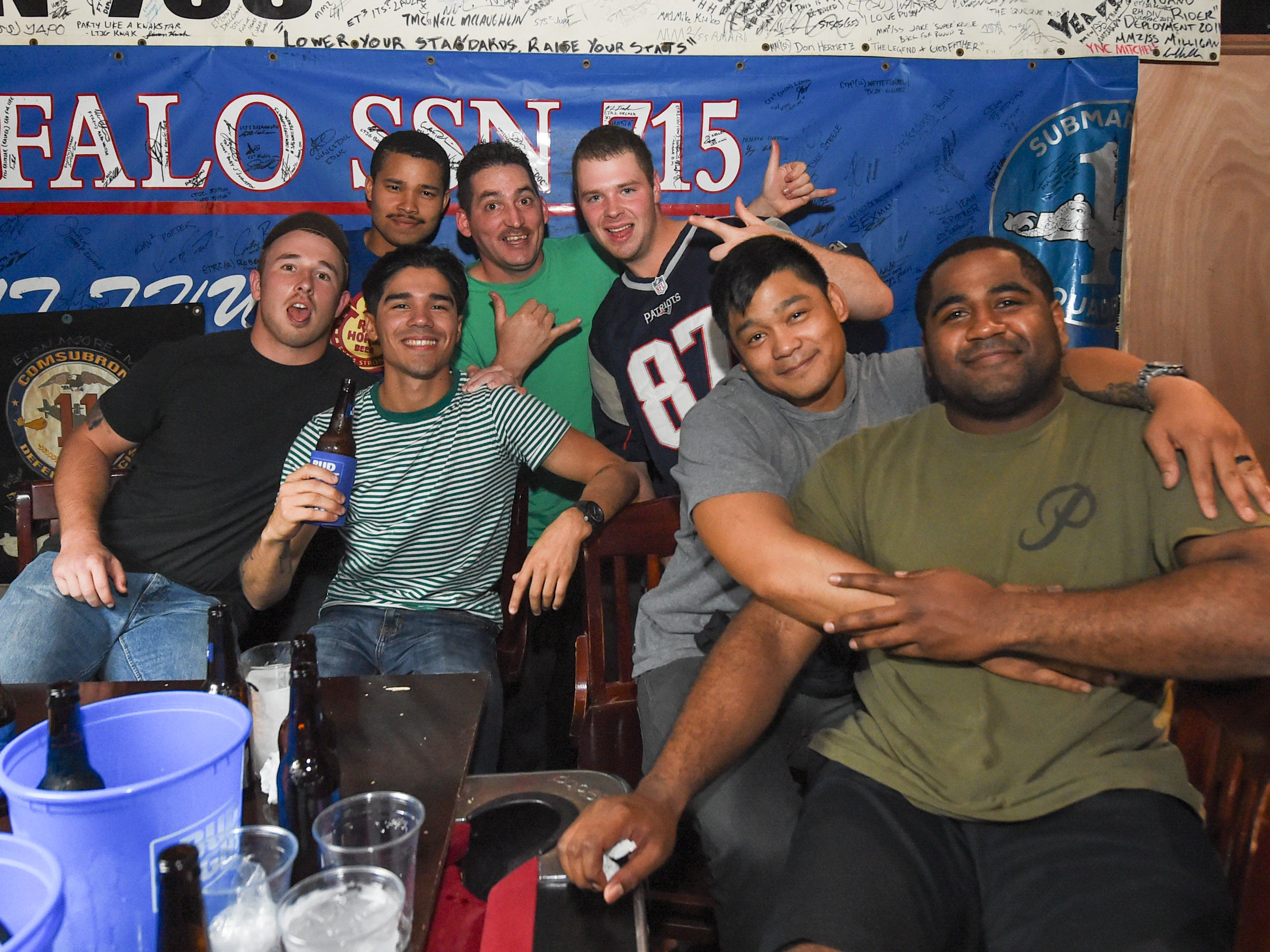 A group of friends hang out at a Horse and Cow a Superbowl 53 party in Tamuning, Feb. 4, 2019.