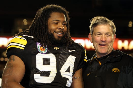 Former Iowa defensive end Adrian Clayborn and current Hawkeyes coach Kirk Ferentz, pictured at the 2010 Orange Bowl, shared another happy moment following the New England Patriots' victory in Super Bowl LIII on Sunday.