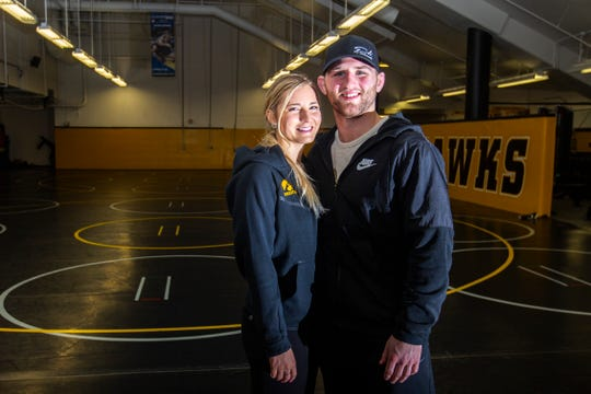 Moriah Stickley and Alex Marinelli pose for a portrait Friday, Feb. 1, 2019, inside the Dan Gable Wrestling Complex at Carver-Hawkeye Arena in Iowa City, Iowa.