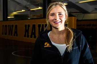 Moriah Stickley, a manager for the Iowa wrestling team, recalls when her late twin brother Eli first started wrestling. Eli died in a car crash last July.