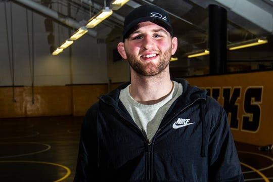 Alex Marinelli poses for a portrait Friday, Feb. 1, 2019, inside the Dan Gable Wrestling Complex at Carver-Hawkeye Arena in Iowa City, Iowa.