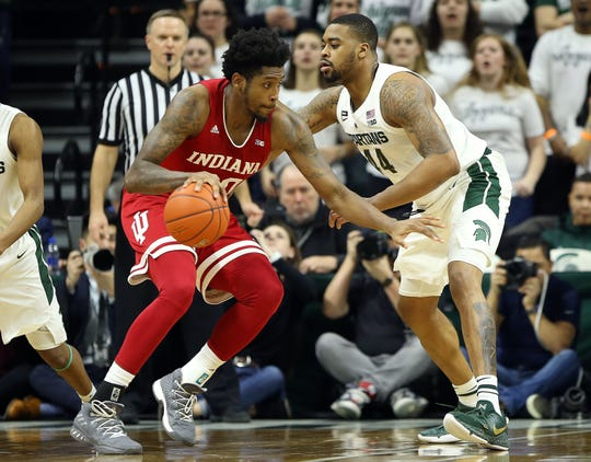 Indiana Hoosiers forward De'Ron Davis (20) controls the ball defended by Michigan State Spartans forward Nick Ward (44) during the second half of a game at the Breslin Center.