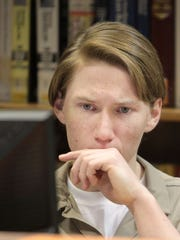 Colt Lundy is shown in the library of the Wabash Valley Correctional Facility on April 7, 2014. He was a co-conspirator, along with Paul Henry Gingerich, in a 2010 murder.