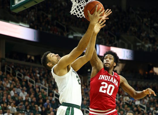 Michigan State Spartans forward Kenny Goins (25) is defended by Indiana Hoosiers forward De'Ron Davis (20) during the second half of a game at the Breslin Center.