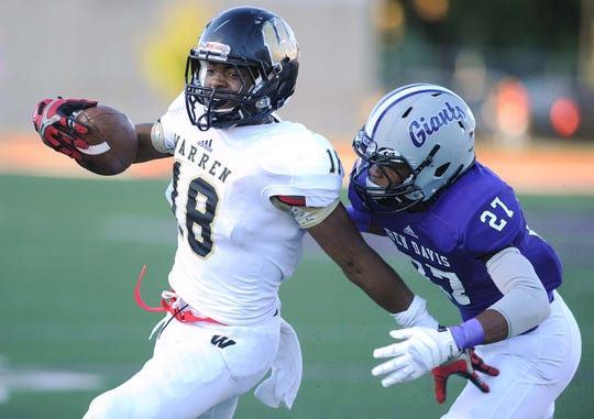 Mykelti Williams of Warren Central runs for a touchdown against Ben Davis in 2013.